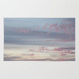 Colorful clouds in sunset Rug