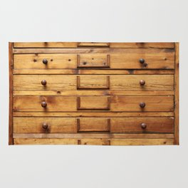 Wooden cabinet with drawers Rug