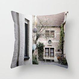 A quaint alley in the beguinage Throw Pillow
