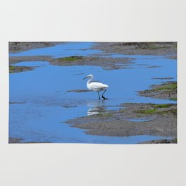 egret in brown and blue Rug