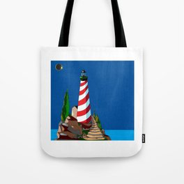 An Eclipse at the Coast with a Lighthouse in Foreground Tote Bag
