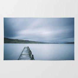 Jetty on Lake Windermere with Langdale Pikes beyond. Millerground Landing, Lake District, UK. Rug