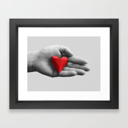 hand with red heart Framed Art Print