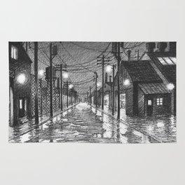 Raining on industrial street Rug