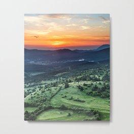 Beautiful sunset behind green fields Metal Print