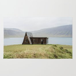 House in front of the lake Rug